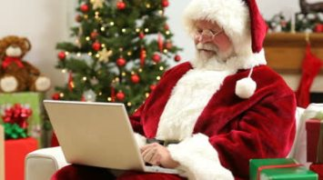 stock-footage-santa-claus-sitting-with-laptop-computer